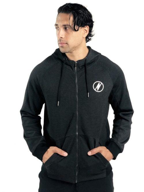 Male model wearing a Uwila Logo Jacket in Black - Front View