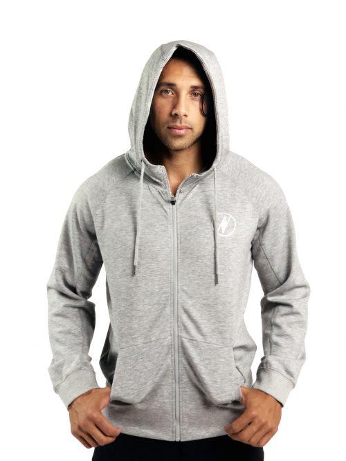 Male model wearing a Uwila Logo Jacket in Grey - Front View