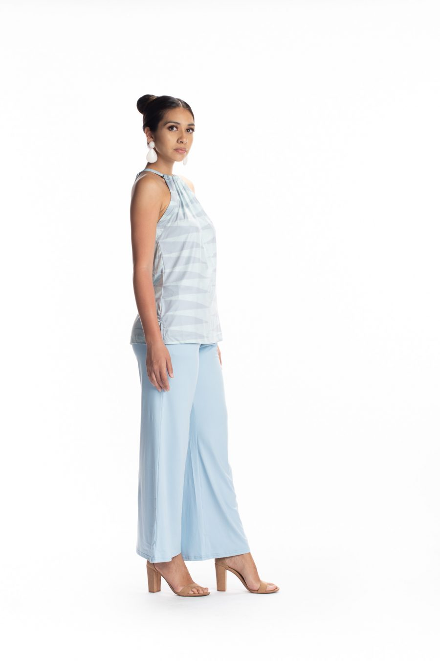 Female model wearing the Awapuhi Pants in Solid Indigo - Side View