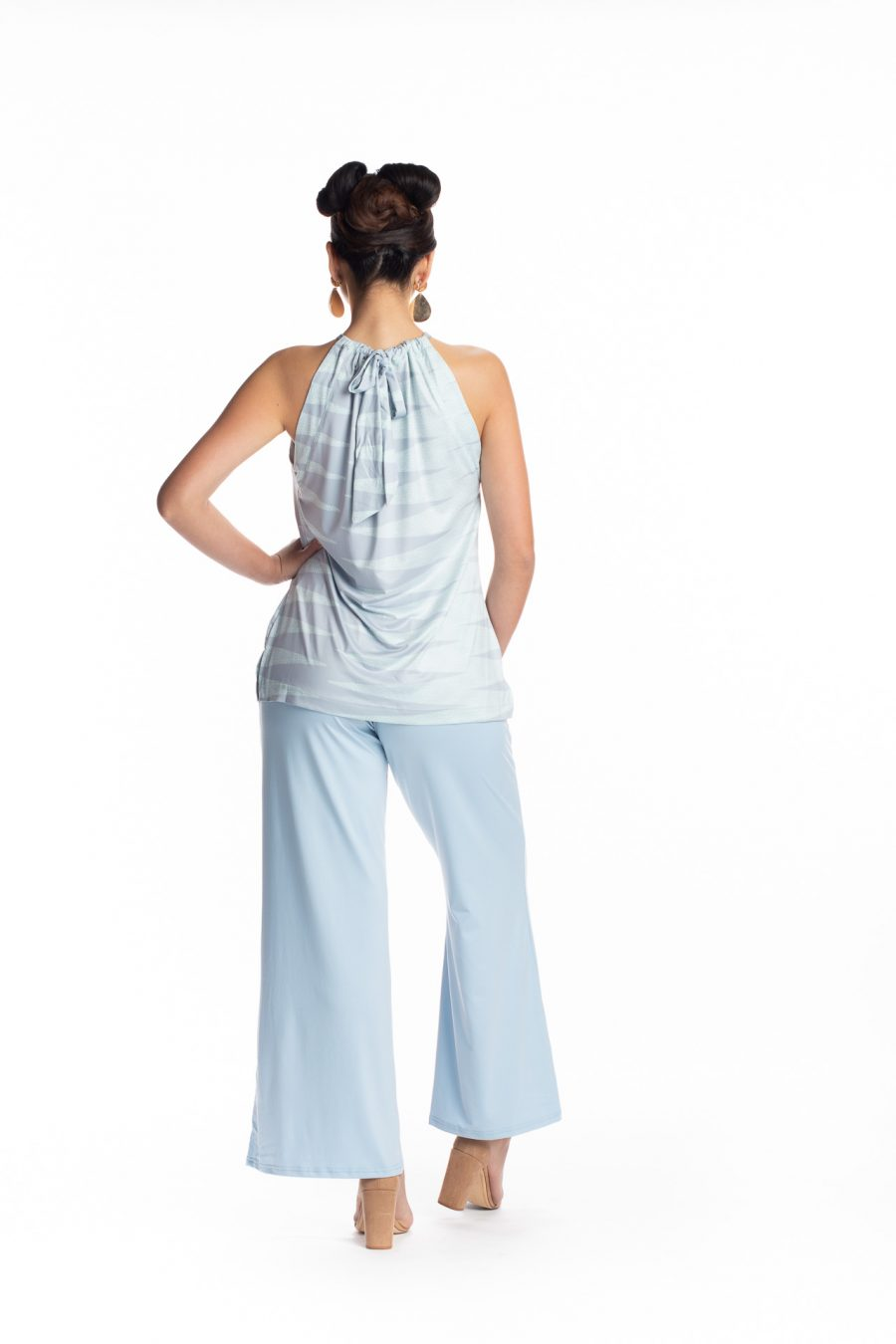 Female model wearing the Awapuhi Pants in Solid Indigo - Back View
