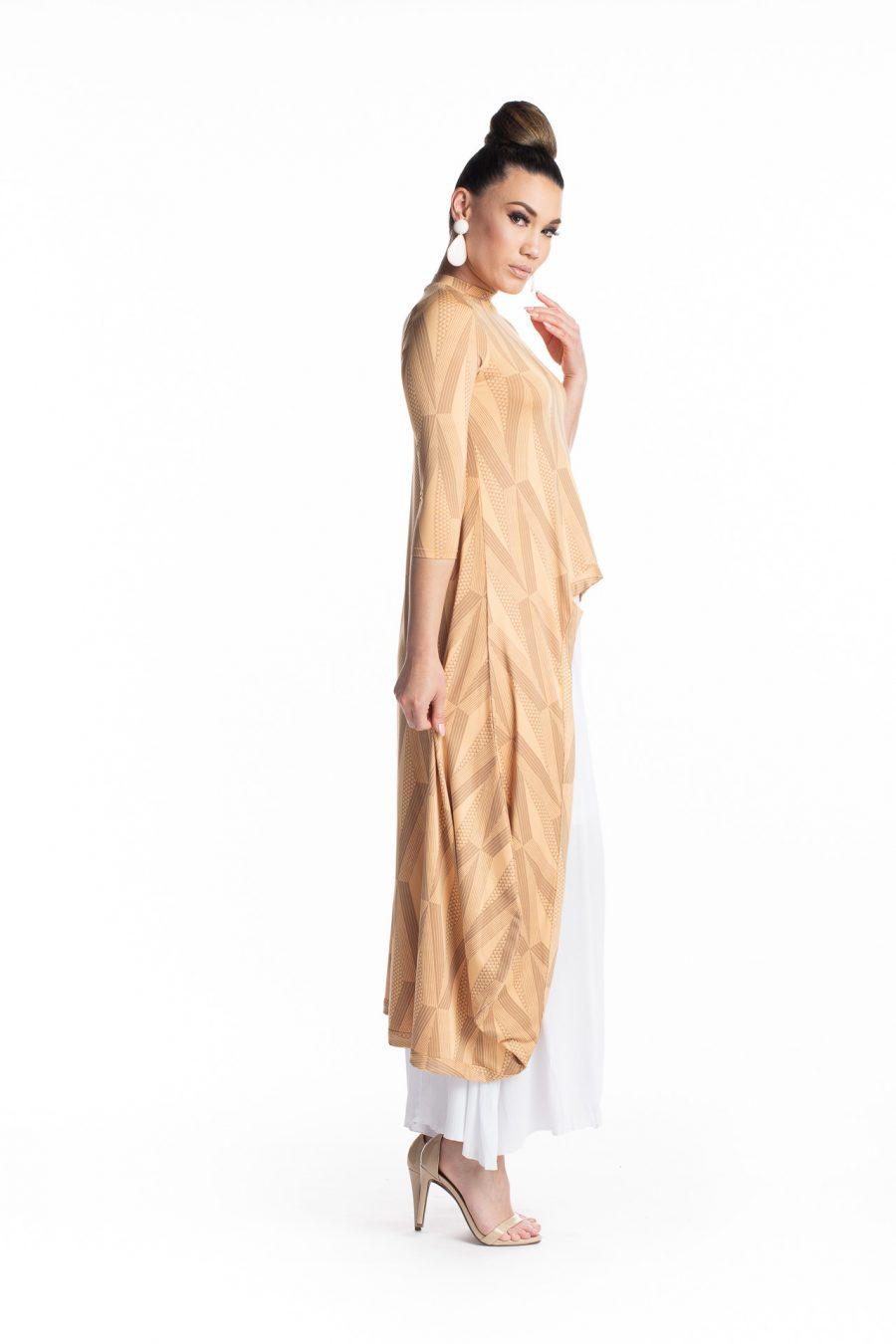 Female model wearing the Kalu Kalu Hi Low Dress in Clay Tannin - Side View