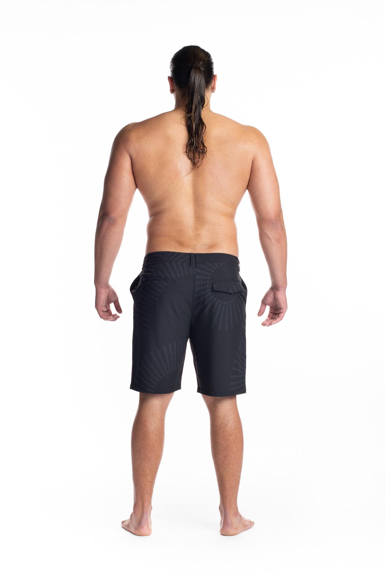 Male model wearing 4 Way Stretch in Black Pewa - Back View