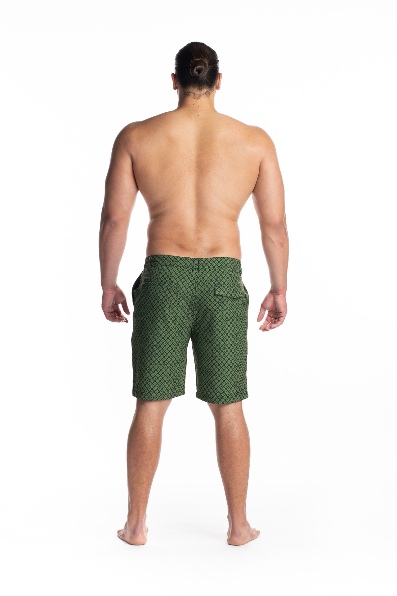 Male model wearing 4 Way Stretch in Black Green Upena - Back View