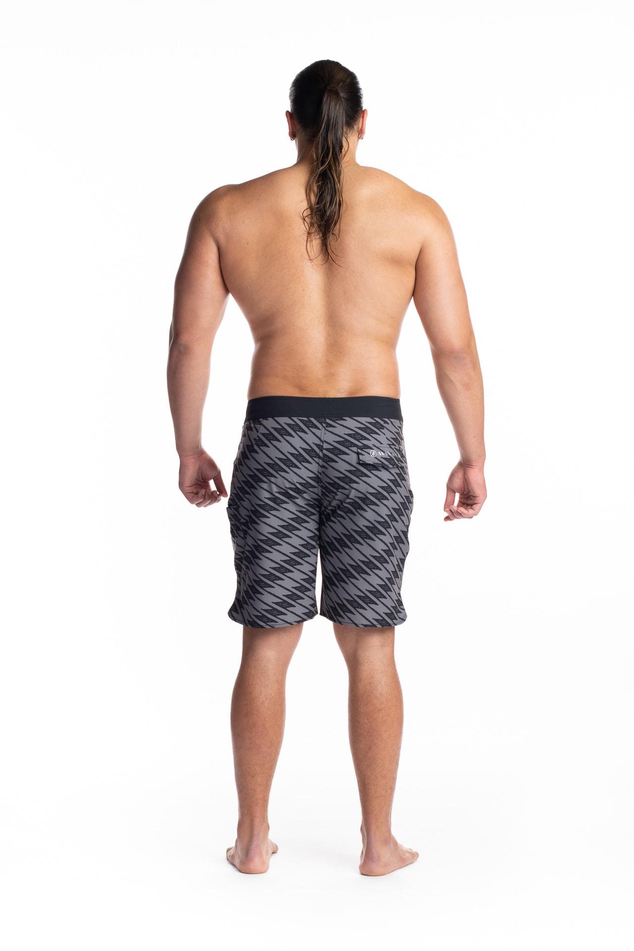 Male model wearing 4 Way Stretch in Black Grey Uwila - Back View