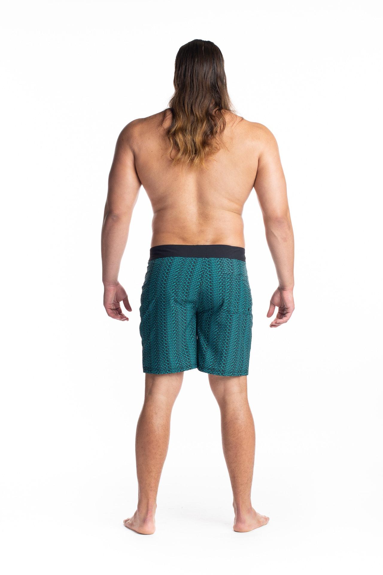Male model wearing 4 Way Stretch in Black Jade Niau - Black View