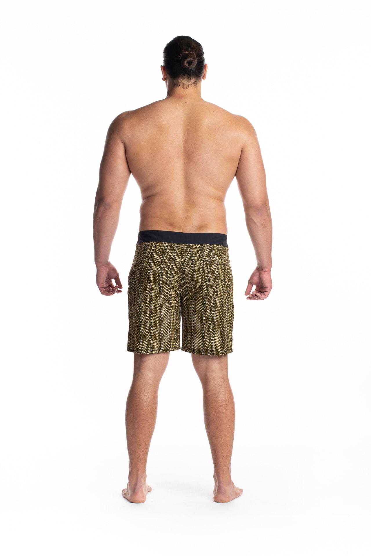 Male model wearing 4-way Stretch in Black Yellow Niau - Back View