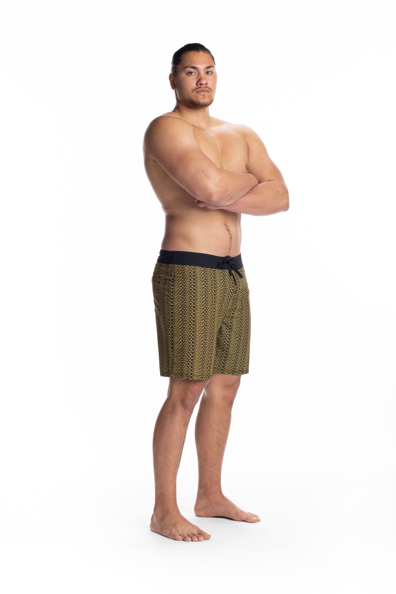 Male model wearing 4-way Stretch in Black Yellow Niau - Side View