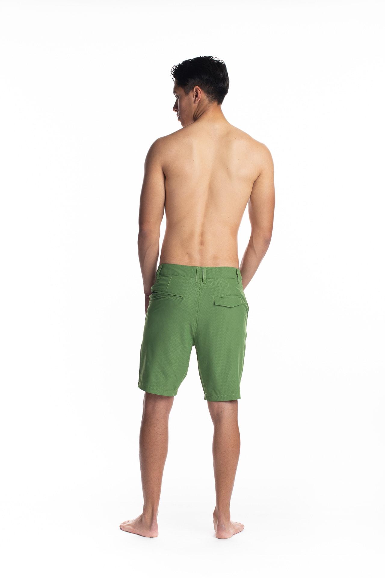 Male model wearing 4-way Stretch in Green Niau - Back View