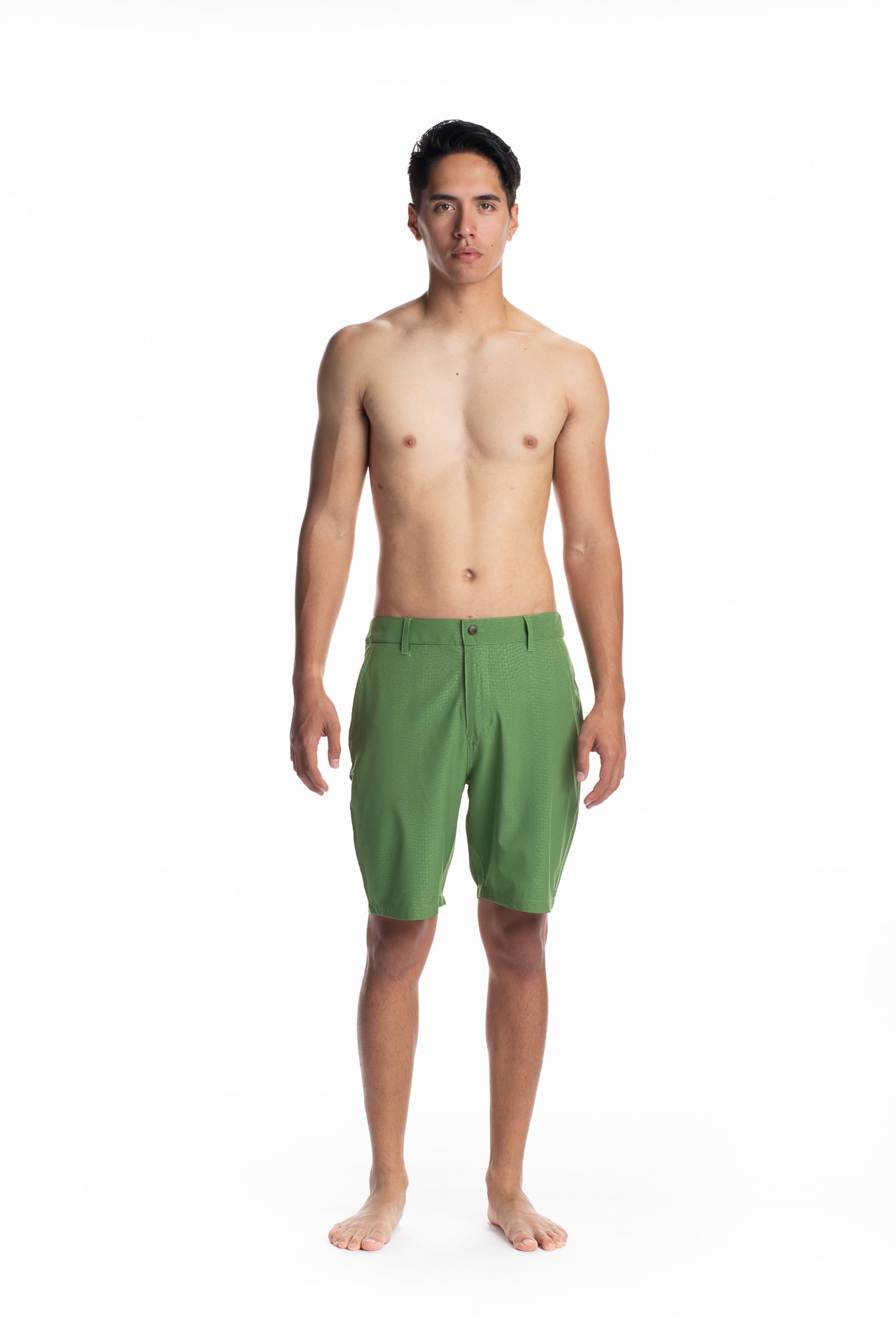 Male model wearing 4-way Stretch in Green Niau - Front View