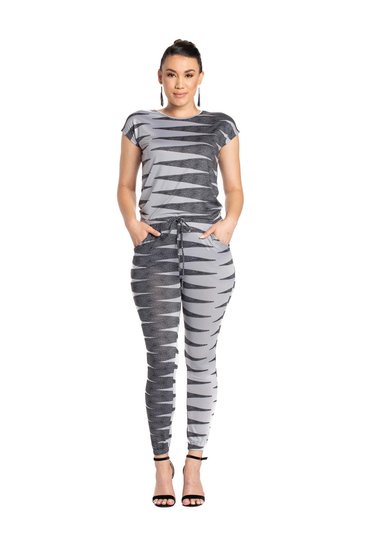Model wearing Lai Jumpsuit in Grey