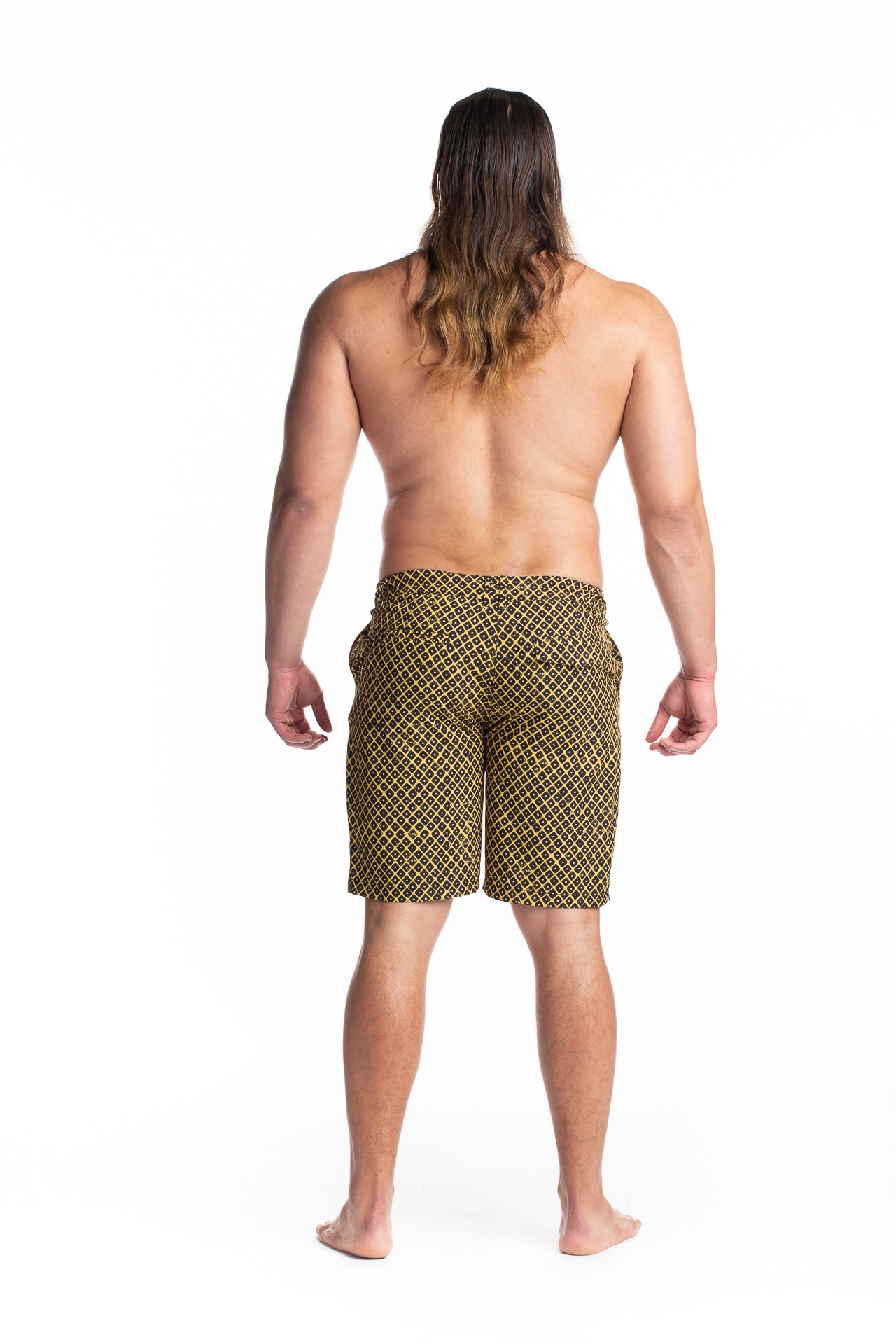 Male model wearing 4-way Stretch in Yellow Black Upena - Back View