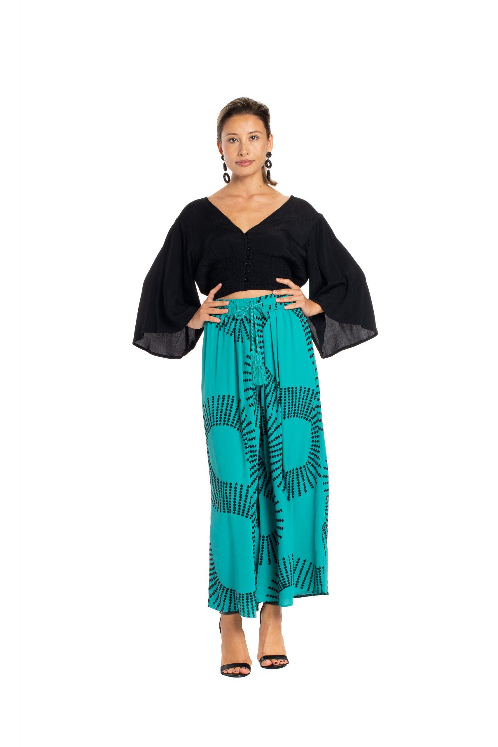 Model wearing Kapakai Flow Pant in Blue Grass - Front View