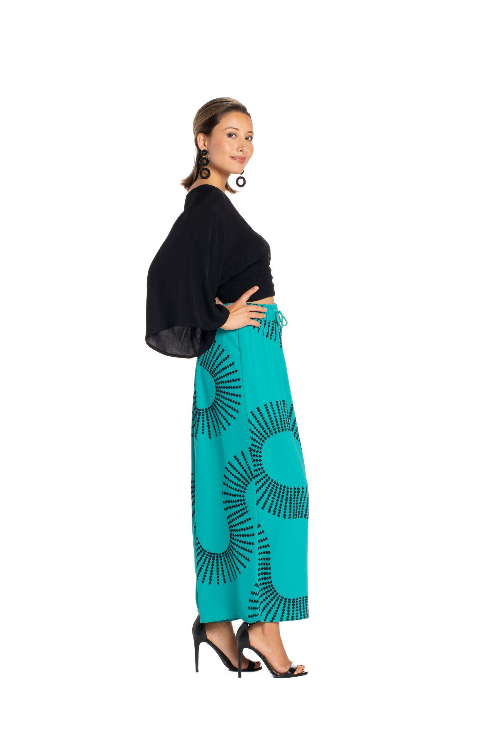 Model wearing Kapakai Flow Pant in Blue Grass - Side View