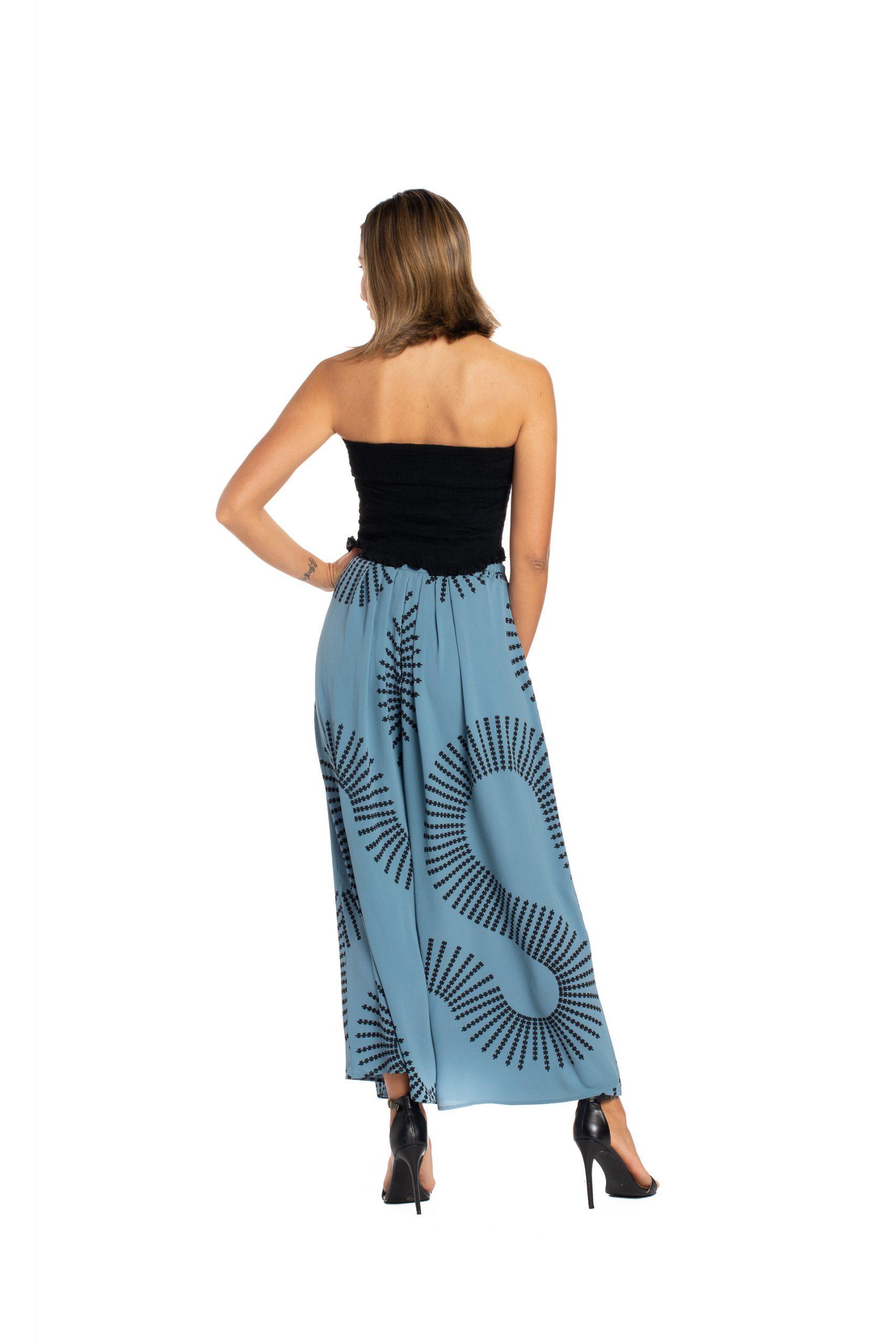 Model wearing Kapakai Flow Pant in Pro. Blue - Back View
