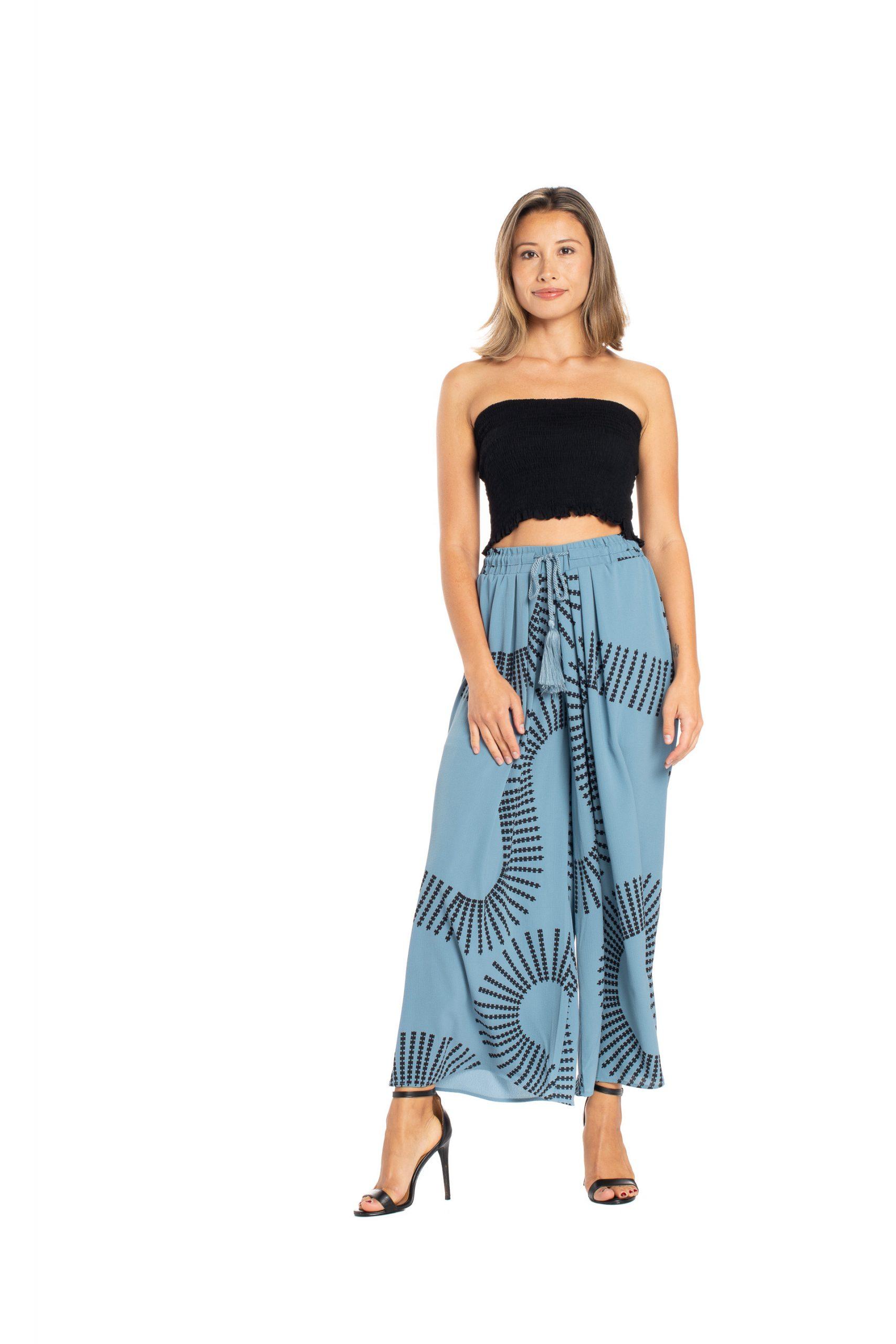Model wearing Kapakai Flow Pant in Pro. Blue - Front View
