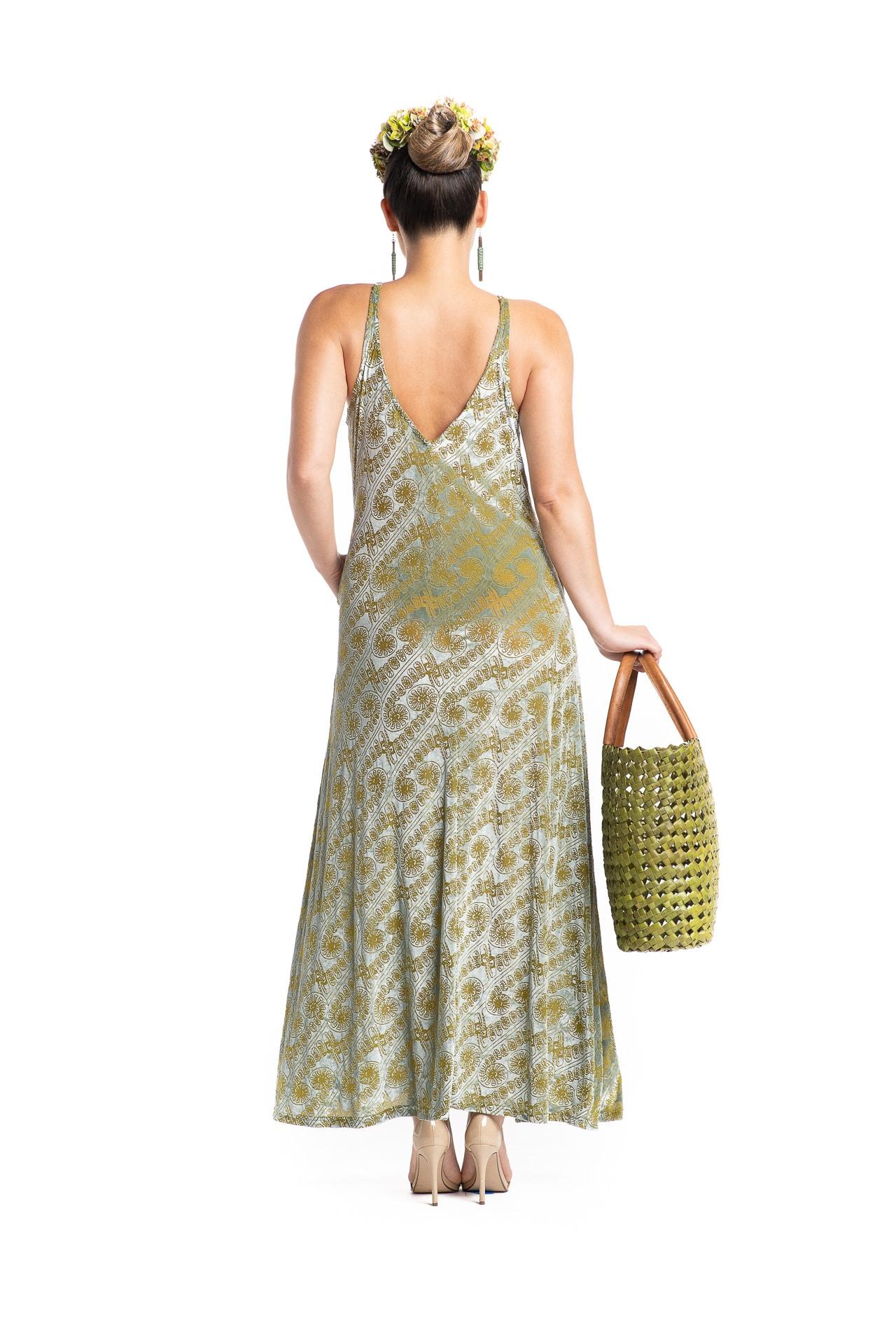 Model wearing Kainaliu Maxi Dress in Amau Sage Green - Back View