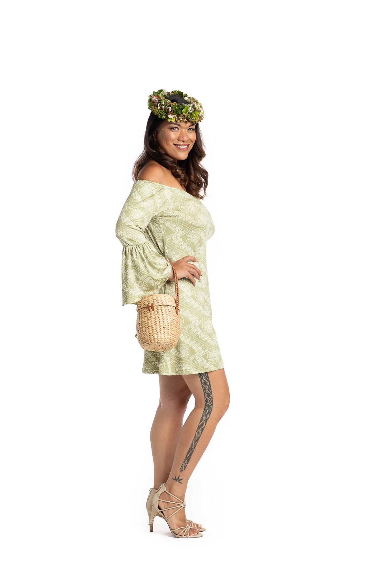 Model wearing Mele Short Dress in Amau Green - Side View