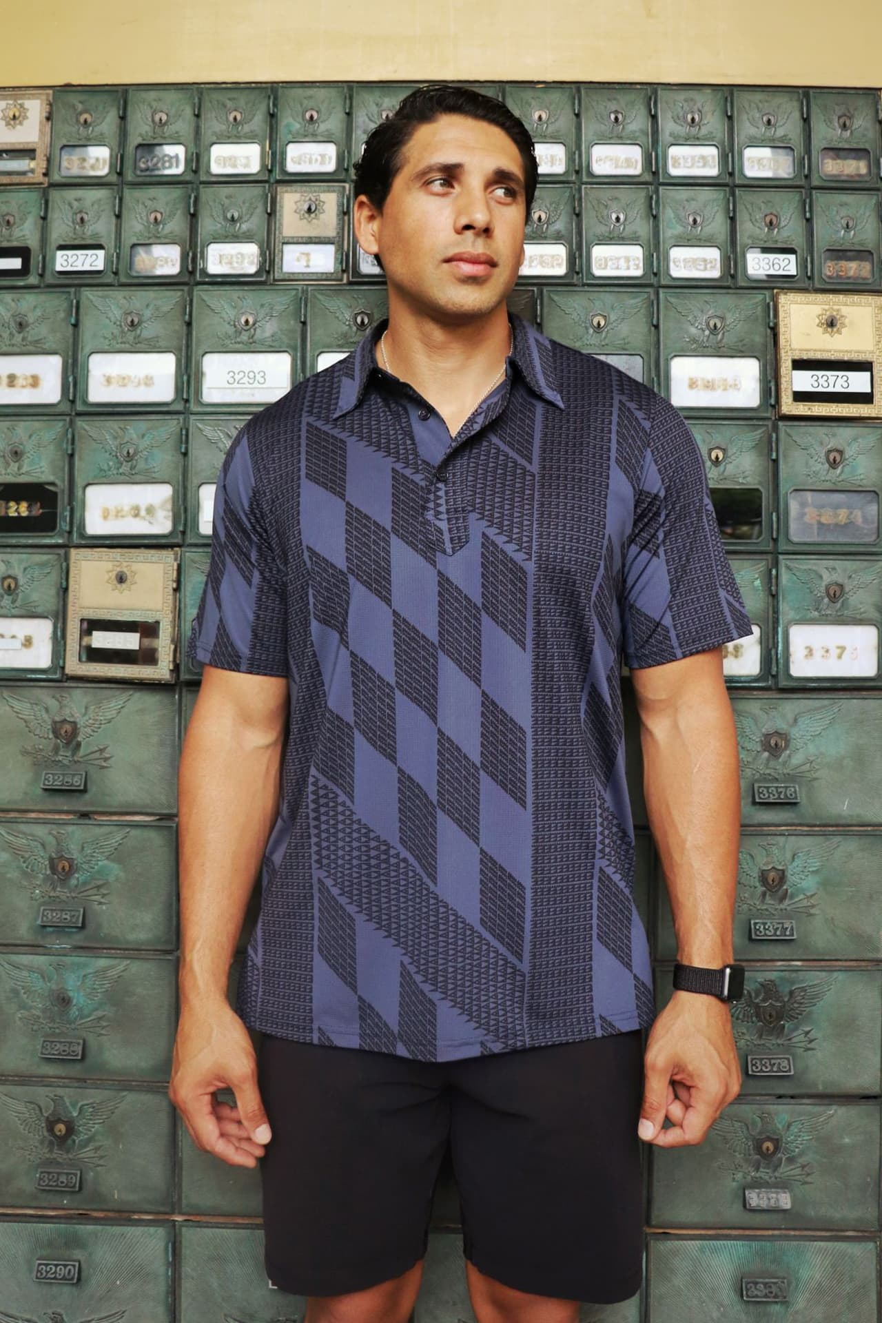 Male model wearing Golf Aloha Shirt in Kamehameha Folkstone Grey