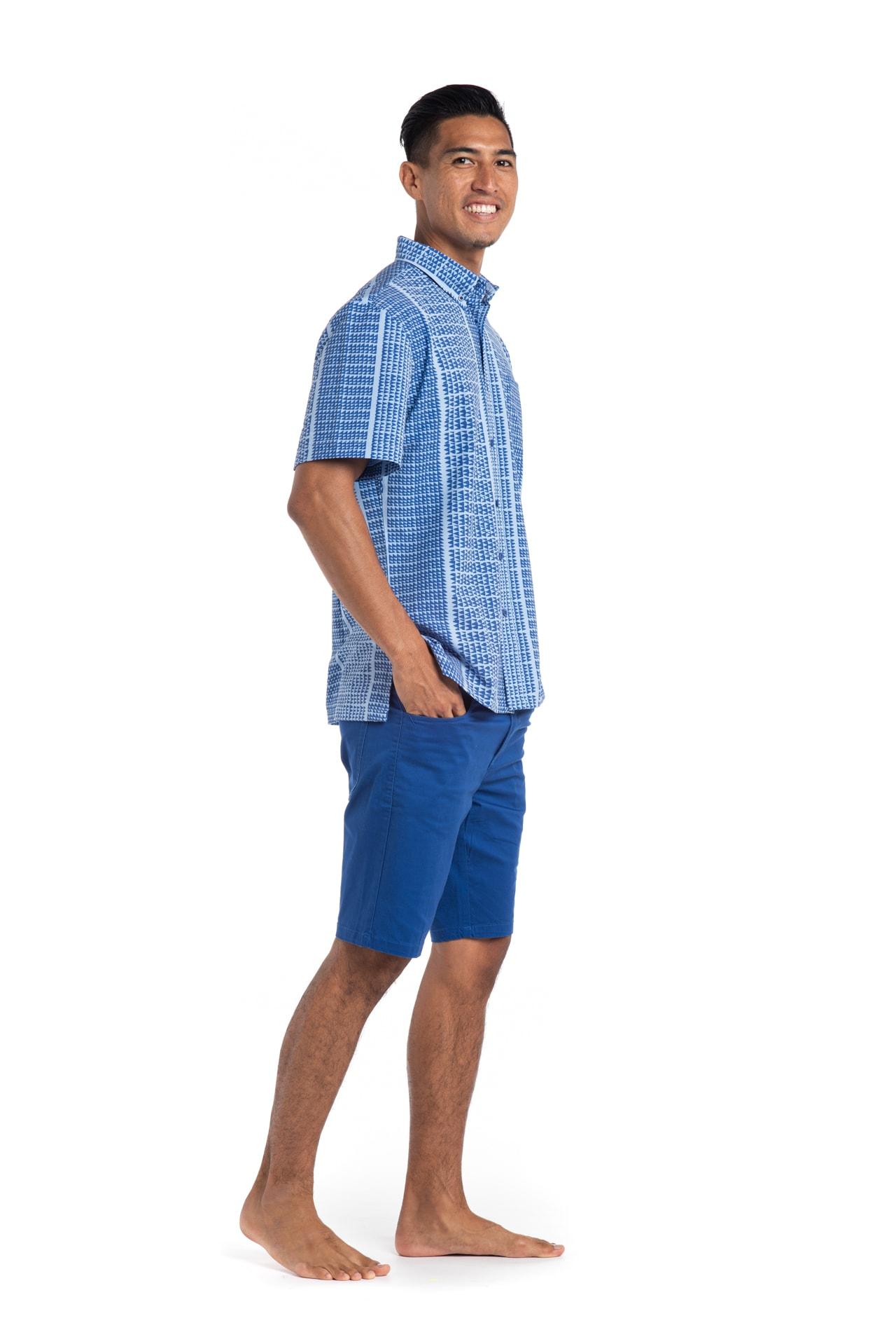 Male model wearing Mahalo Nui Shirt in Blue Niho Ku - Side View