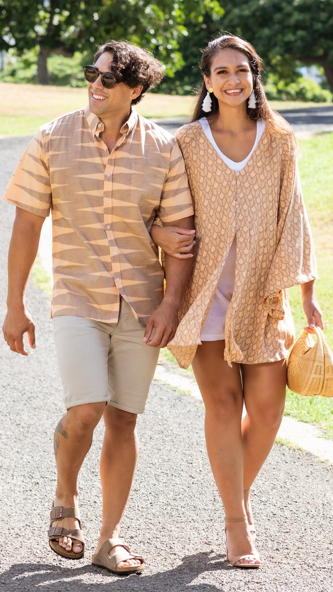 Two models wearing mailei and nanaka aloha shirt duo pack