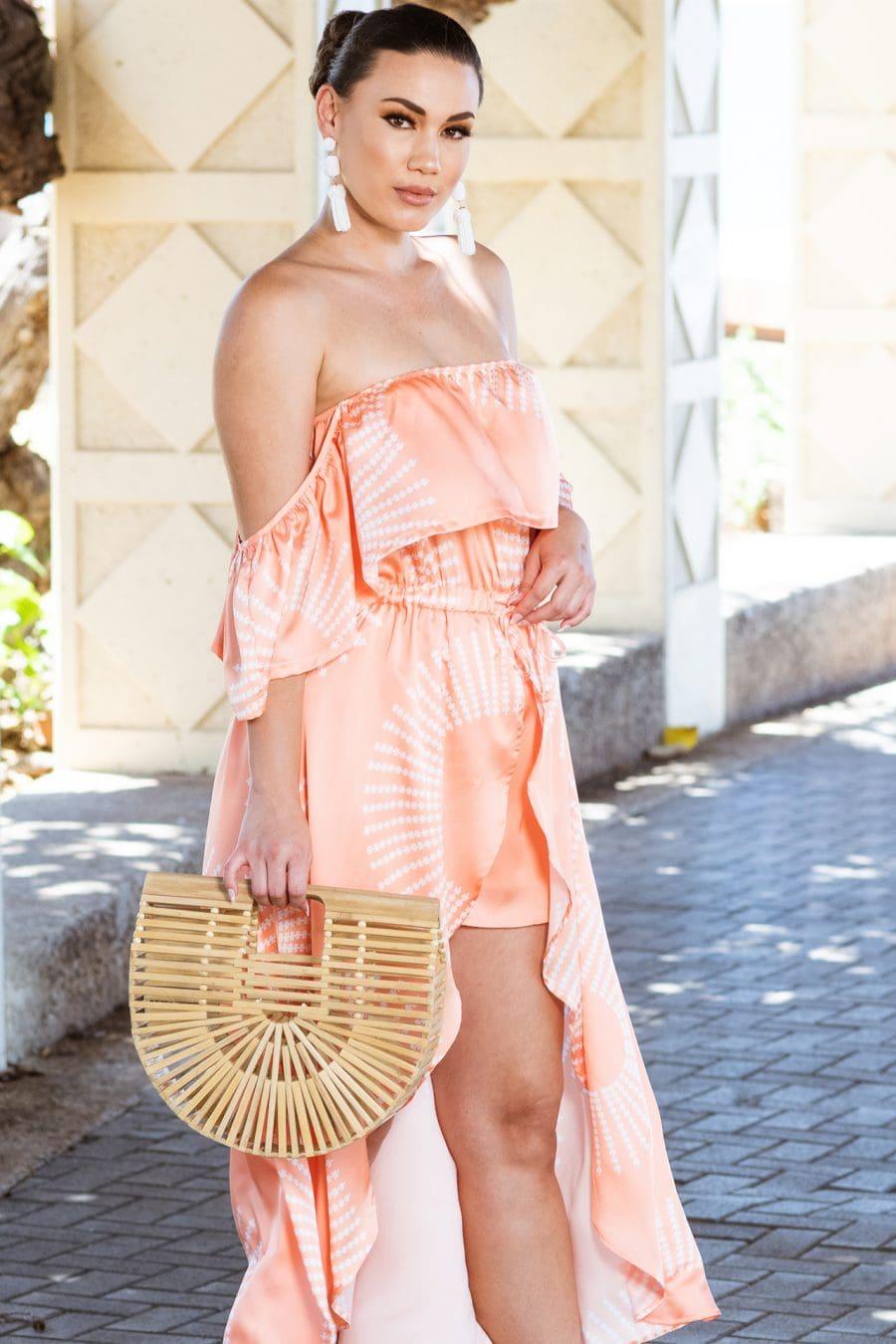 Model wearing Makani Olu in Peach