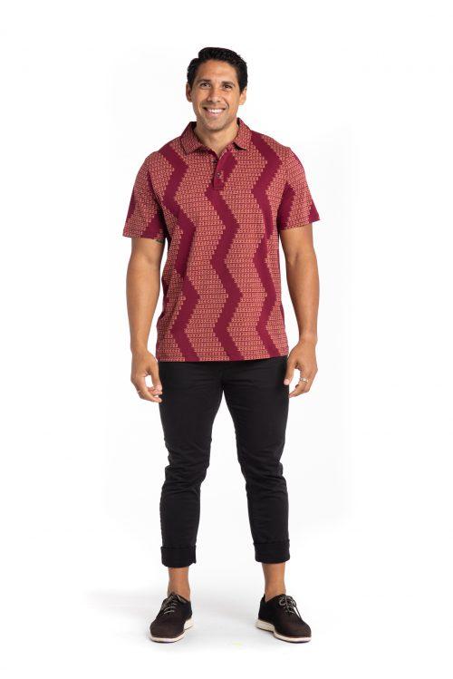 Male model wearing Waikii Polo in Rhod/Copper Brown Niho Mano - Front View