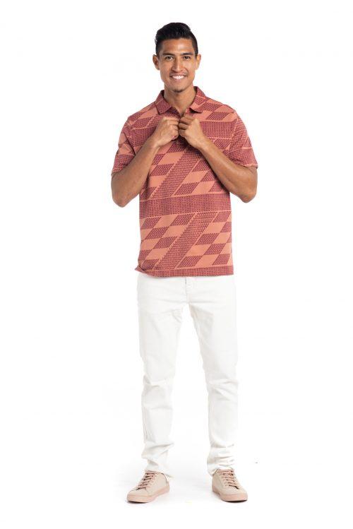 Male model wearing Waikii Polo in Rhod/Copper Brown Kamehameha - Front View