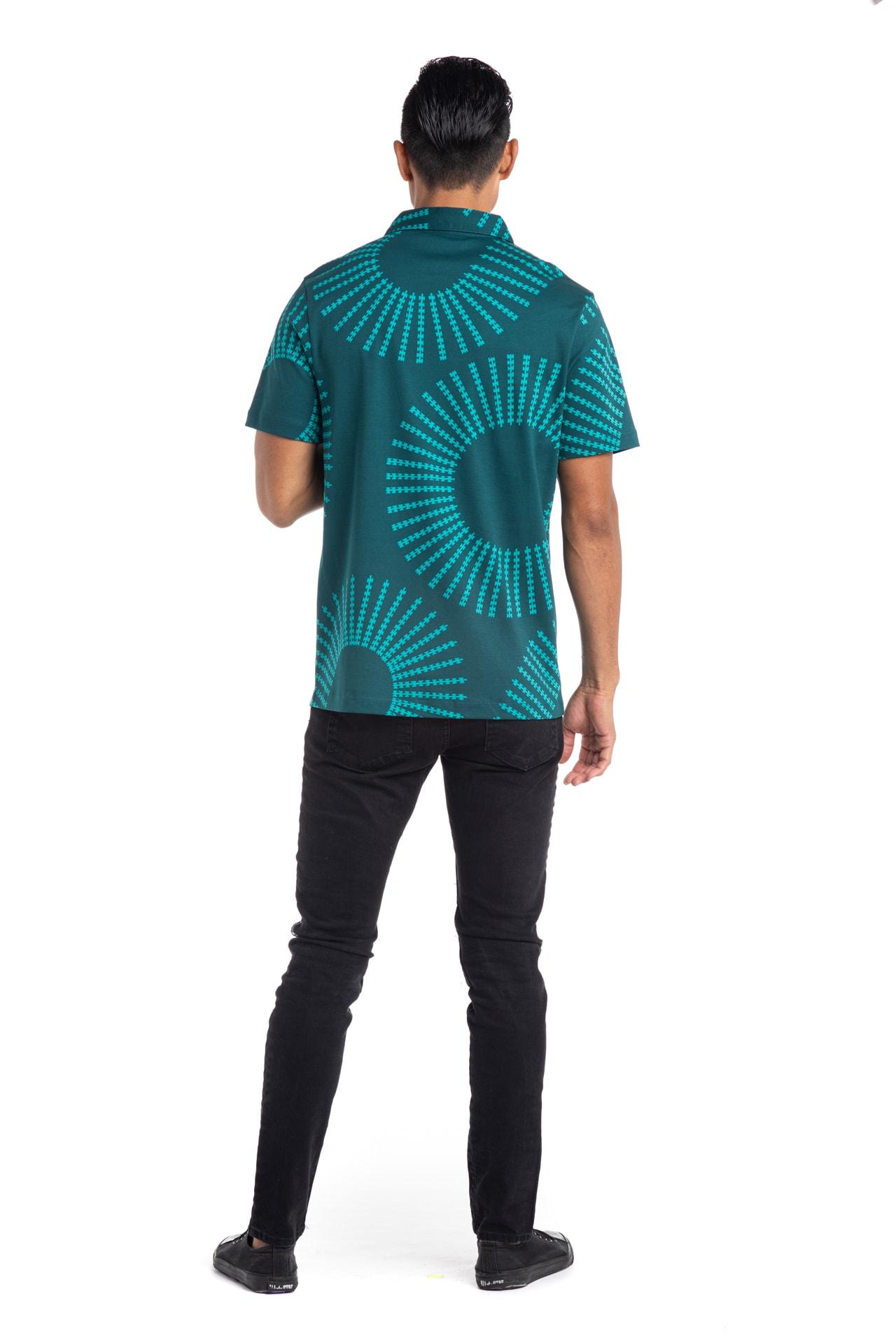 Male model wearing Waikii Polo in Blue Grass/Atlantic - Back View