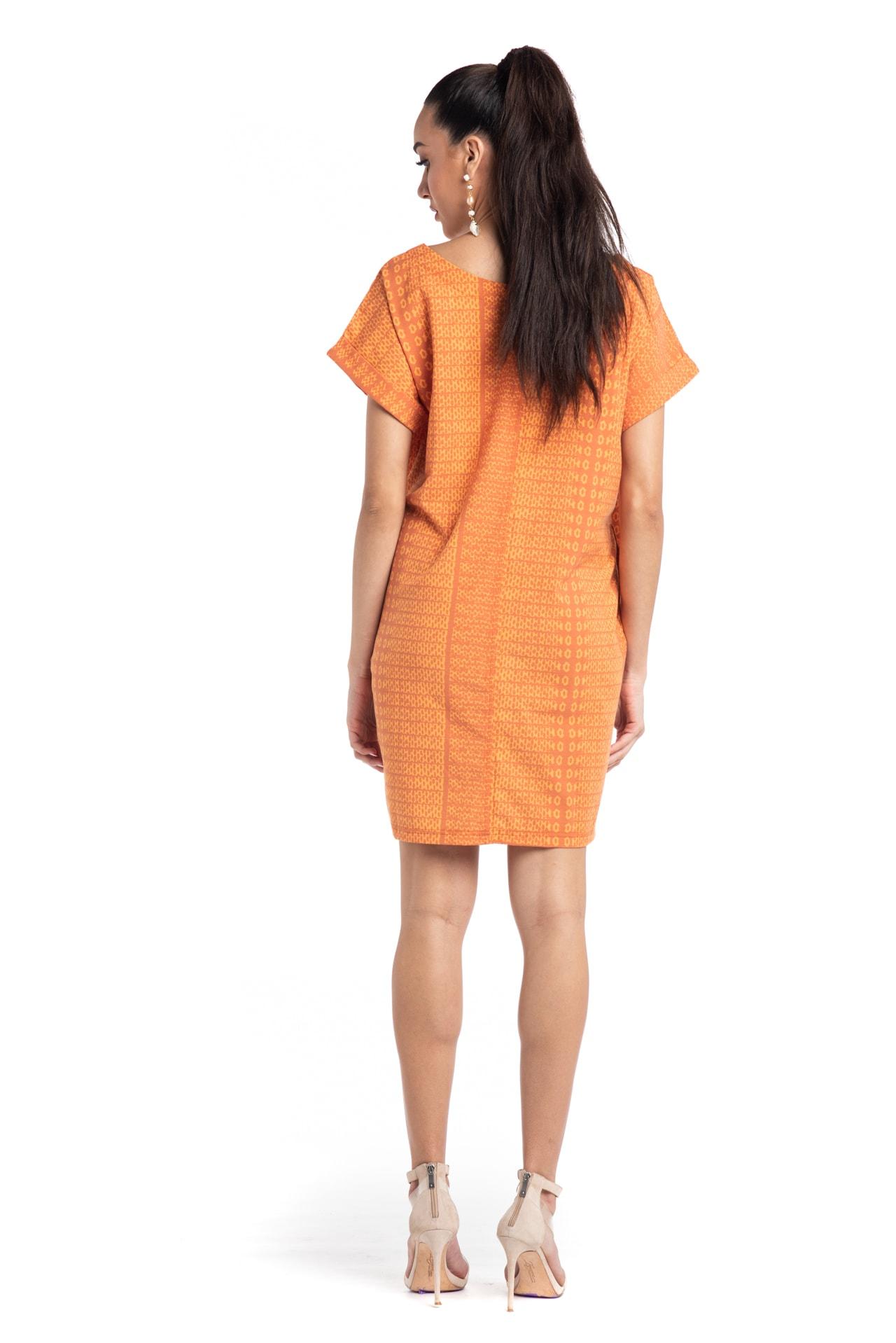 Model wearing Puaniu Shift Dress in Orange AkoaAkoa - Back View