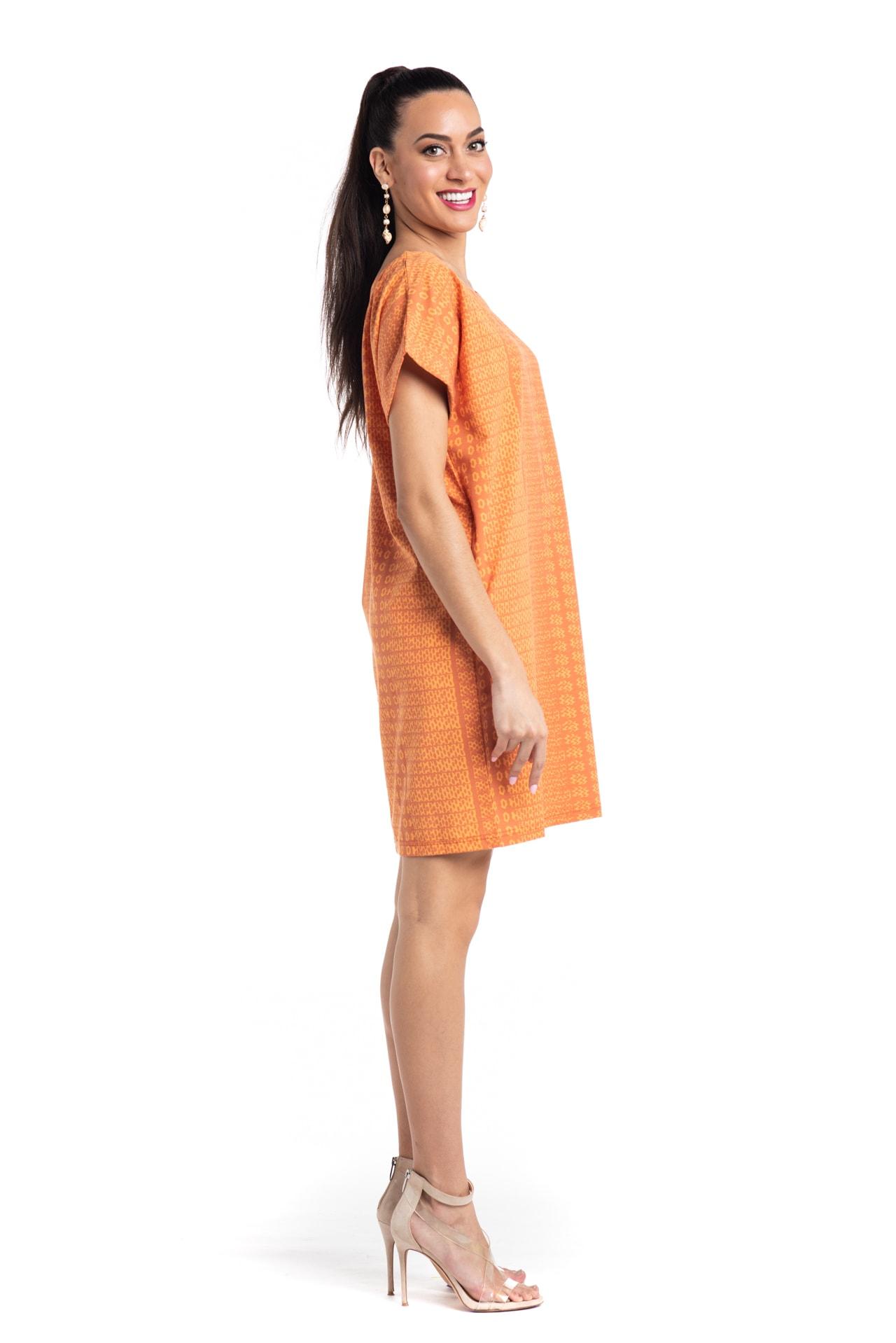 Model wearing Puaniu Shift Dress in Orange AkoaAkoa - Side View
