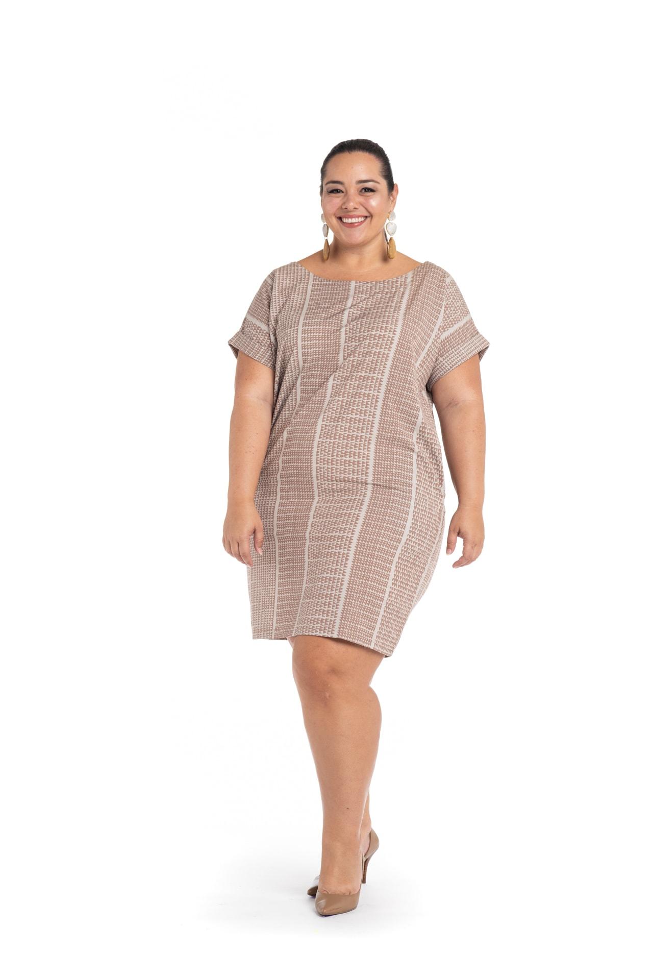 Model wearing Puaniu Shift Dress in Brown Niho Ku - Front View