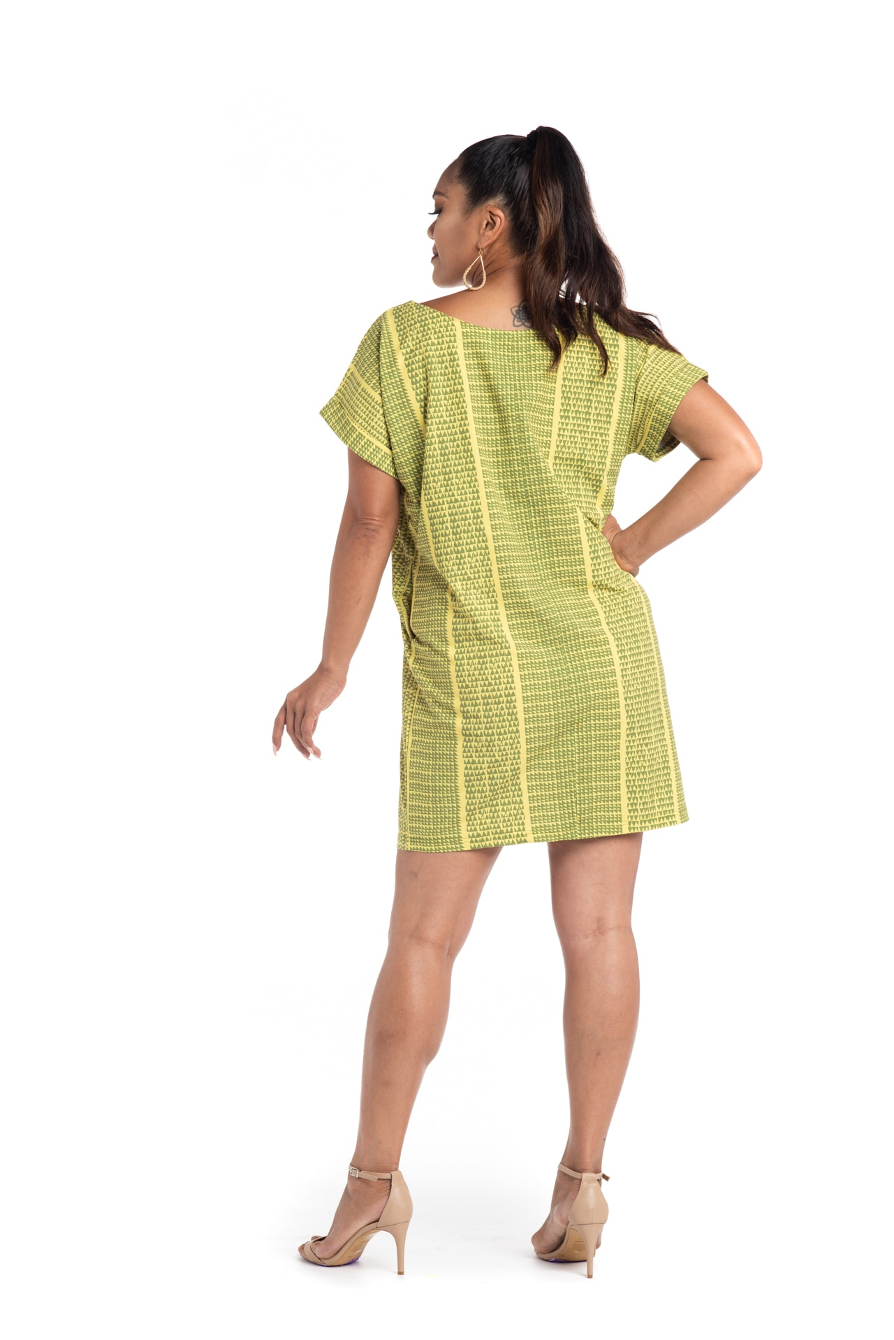 Model wearing Puaniu Shift Dress in Green Niho Ku - Back View