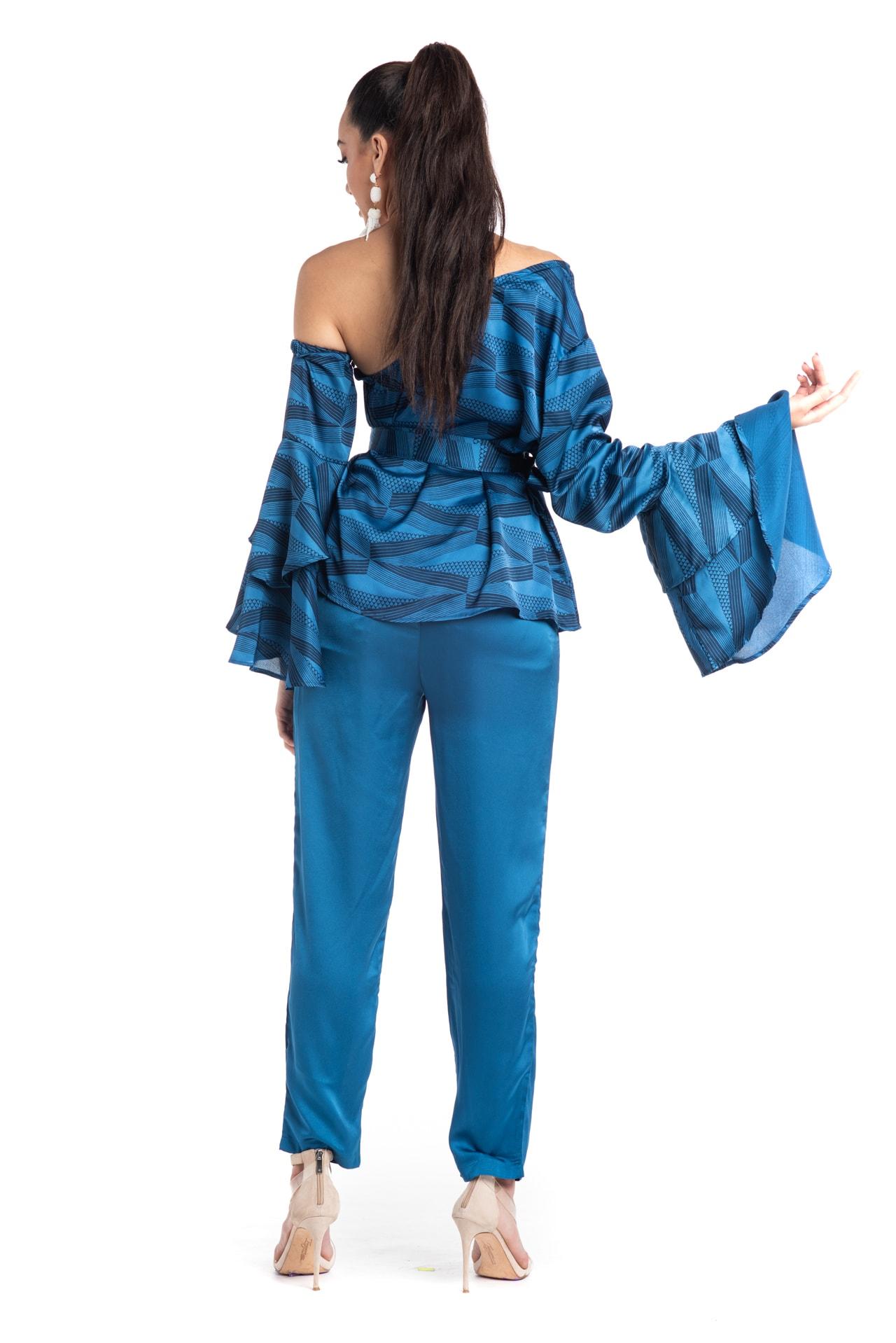 Model wearing Venus Top in Blue - Back View