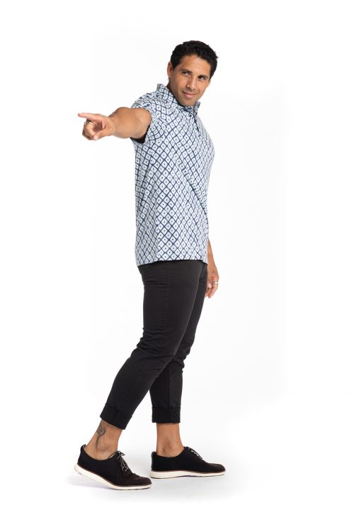 Male model wearing Waikii Polo in Blue Indigo/Celestral Blue Upena
