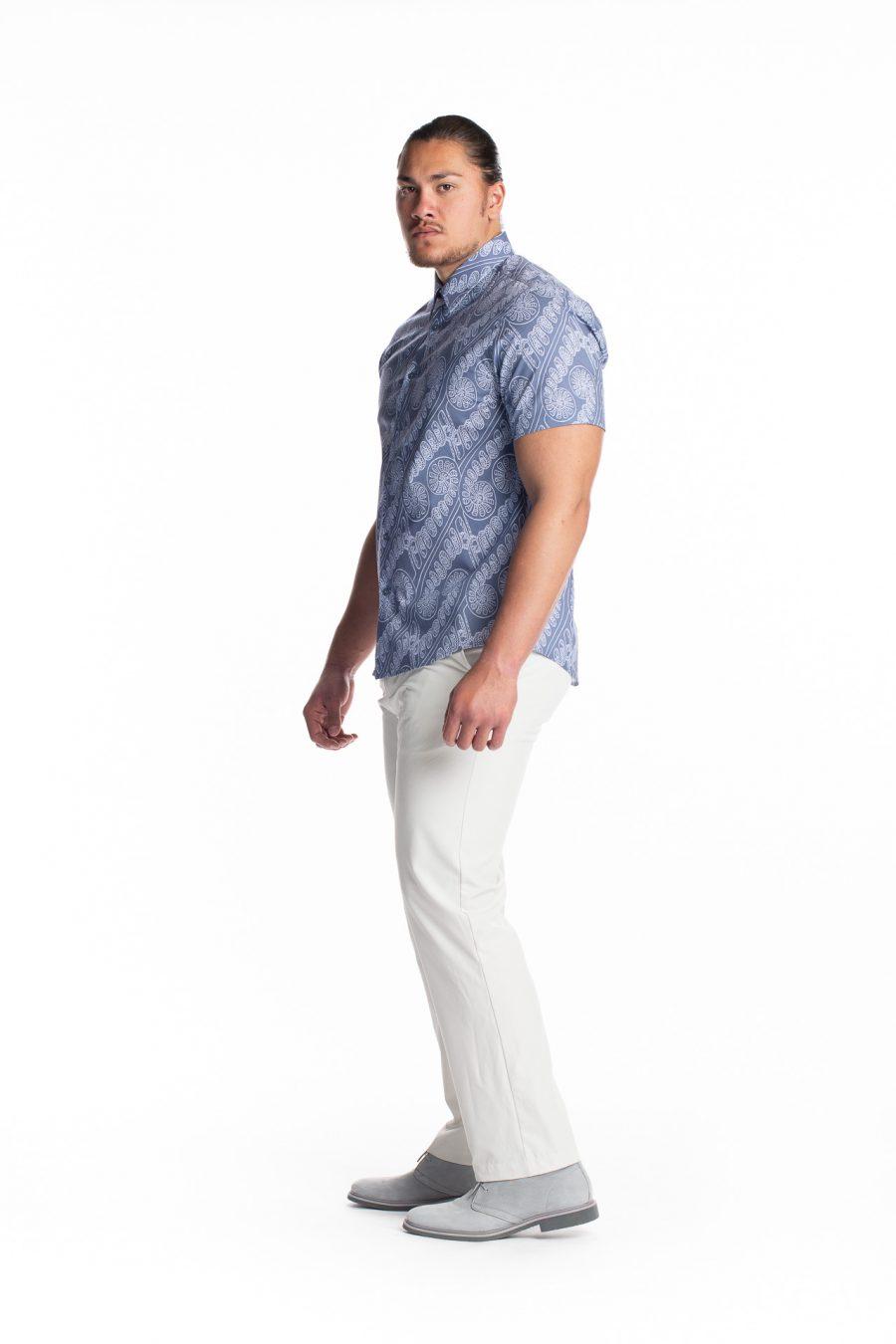 Male model wearing Aloha Short Sleeve in Amau Blue - side view
