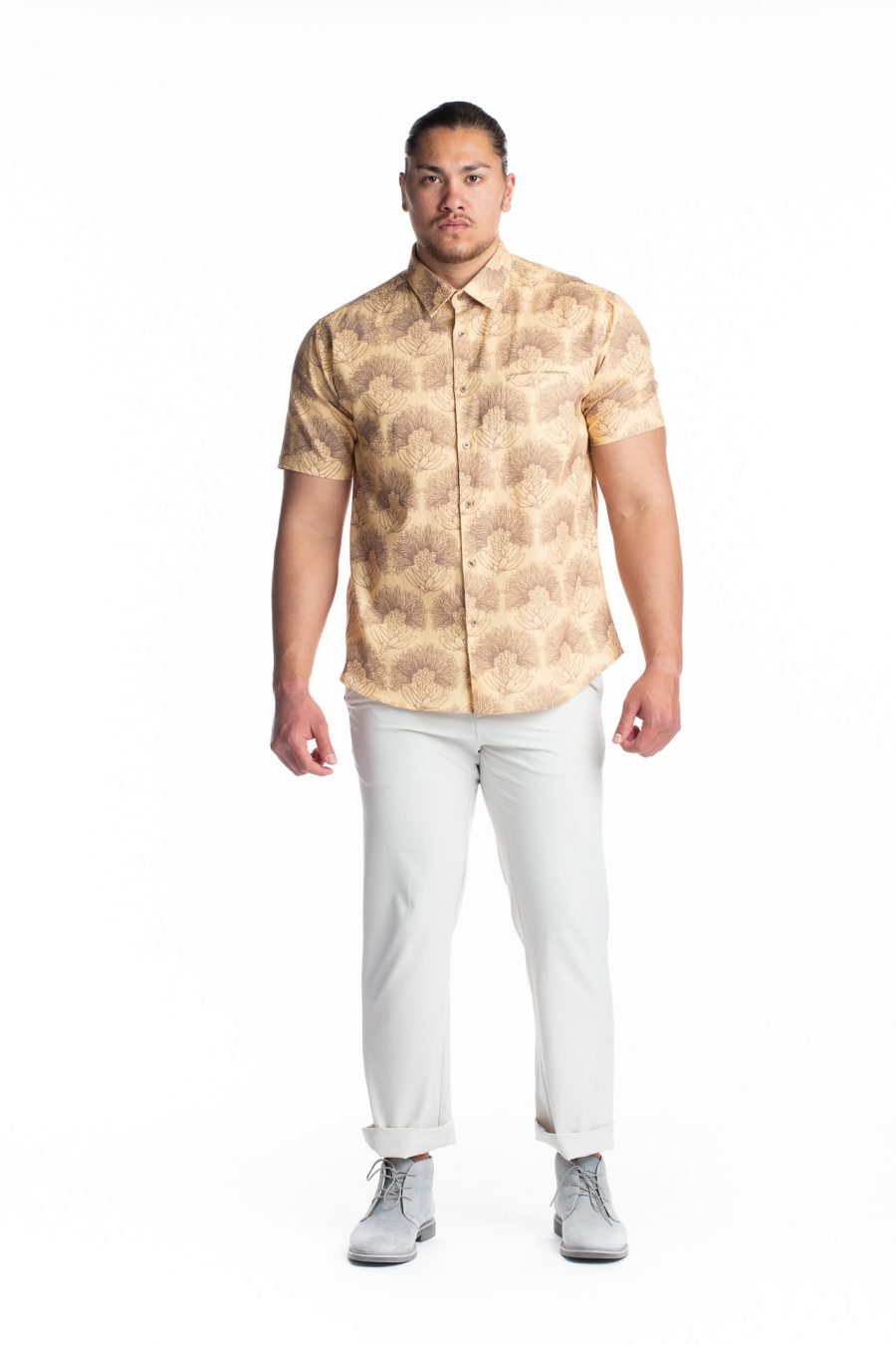 Male model wearing Aloha Short Sleeve in Apricot Sherbert/Gingersnap Kalihilehua pattern - front view