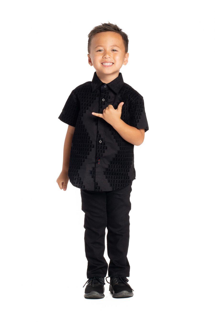 Boy wearing Keiki Aloha Short Sleeve in Black Niho Mano - Front View