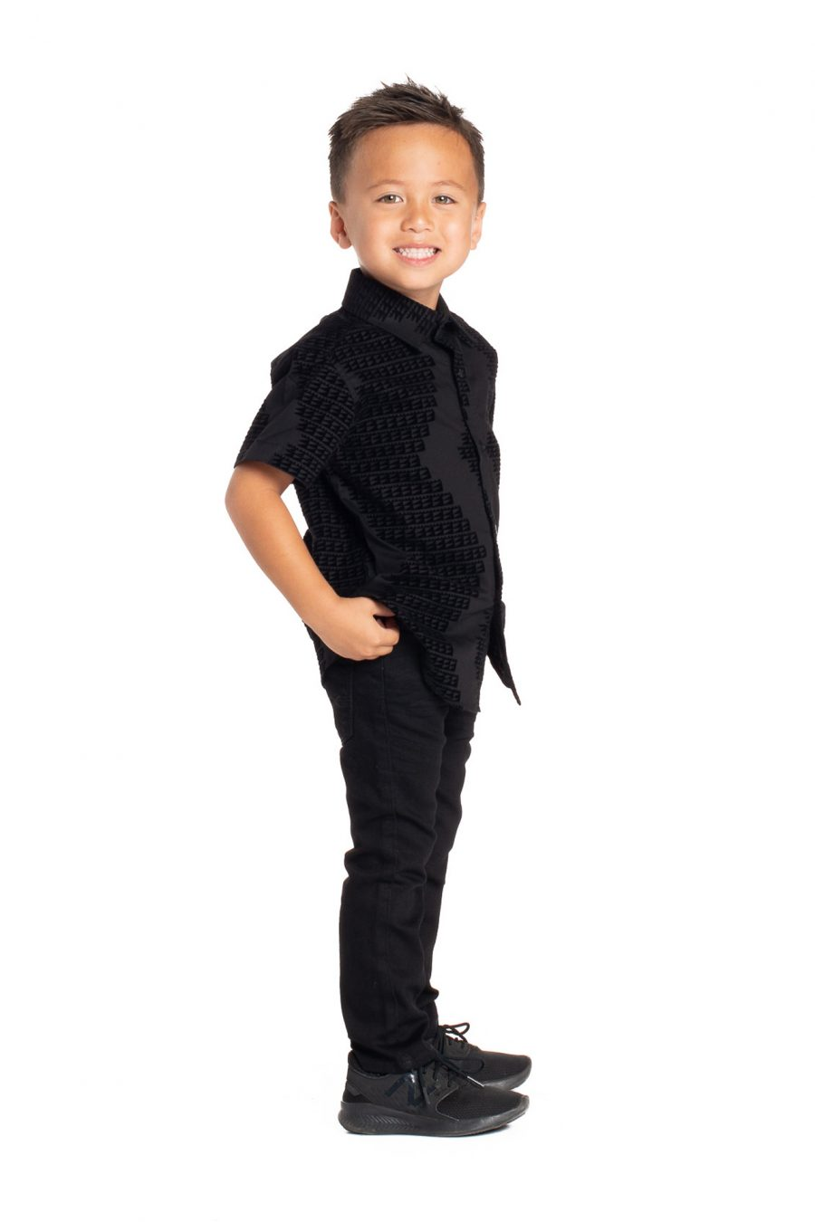 Boy wearing Keiki Aloha Short Sleeve in Black Niho Mano - Side View