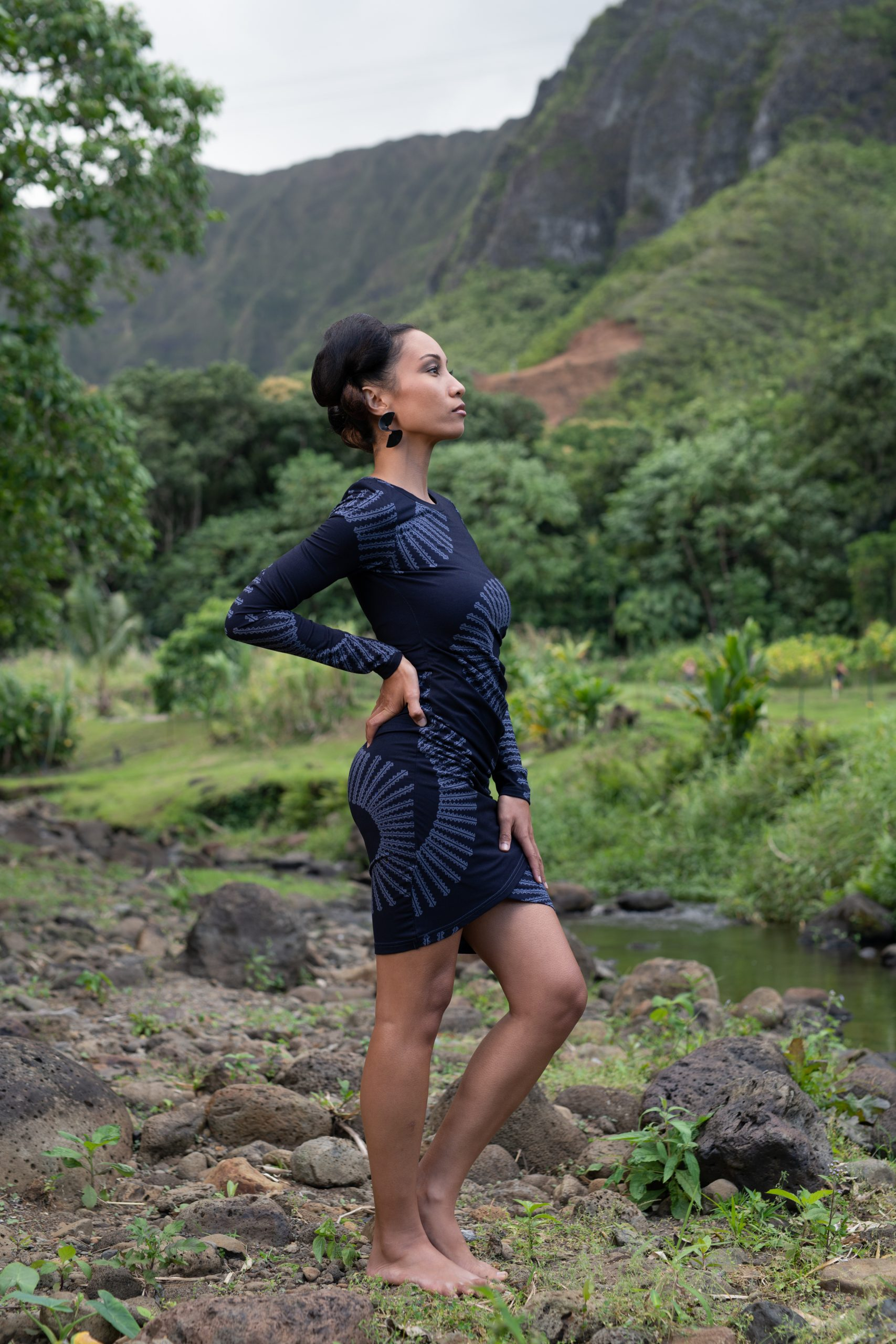Model wearing Waimeli Dress in Deep Well/Folkstone Grey Lalani Kalalea - Side View