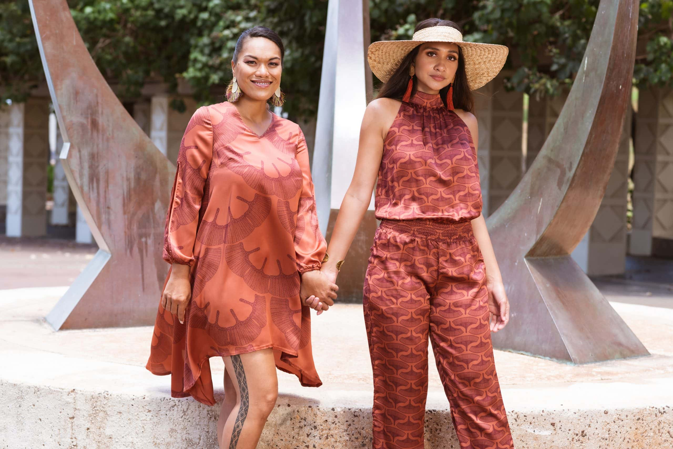 Models wearing Keaolani and Noveo Jumpsuit in Copper/Red Mahagony - Front View