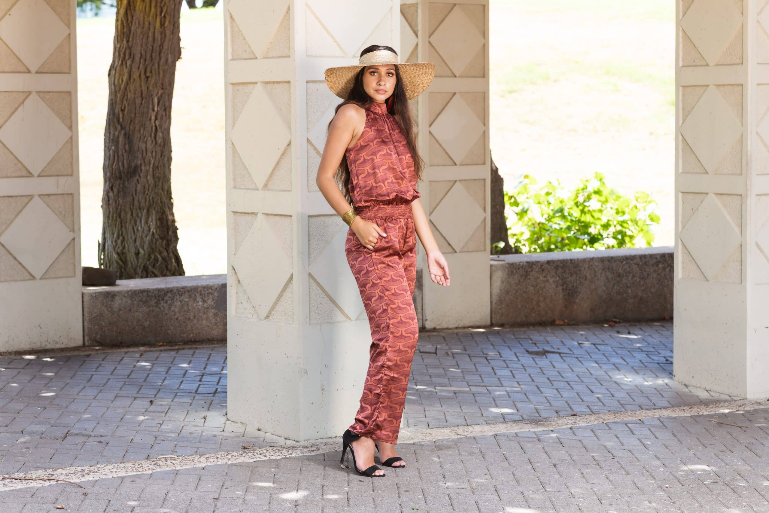 Model wearing Noveo Jumpsuit in Copper/Red Mahagony Peahi Moi - Front View