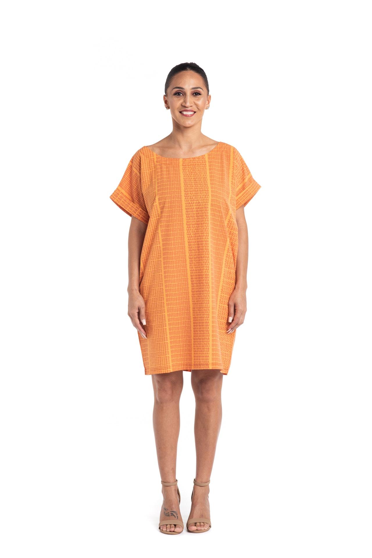 Model wearing Puaniu Shift Dress in Orange - Front View