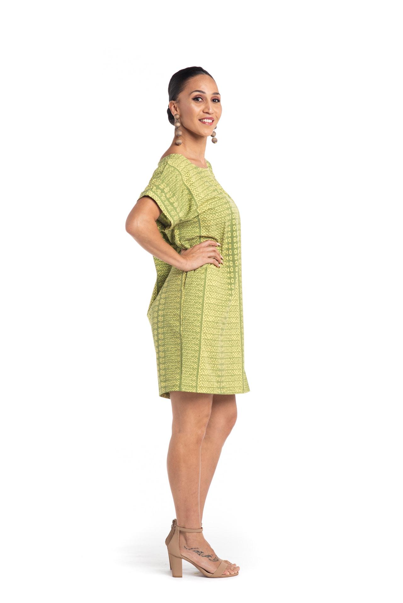 Model wearing Puaniu Shift Dress in Green - Side View