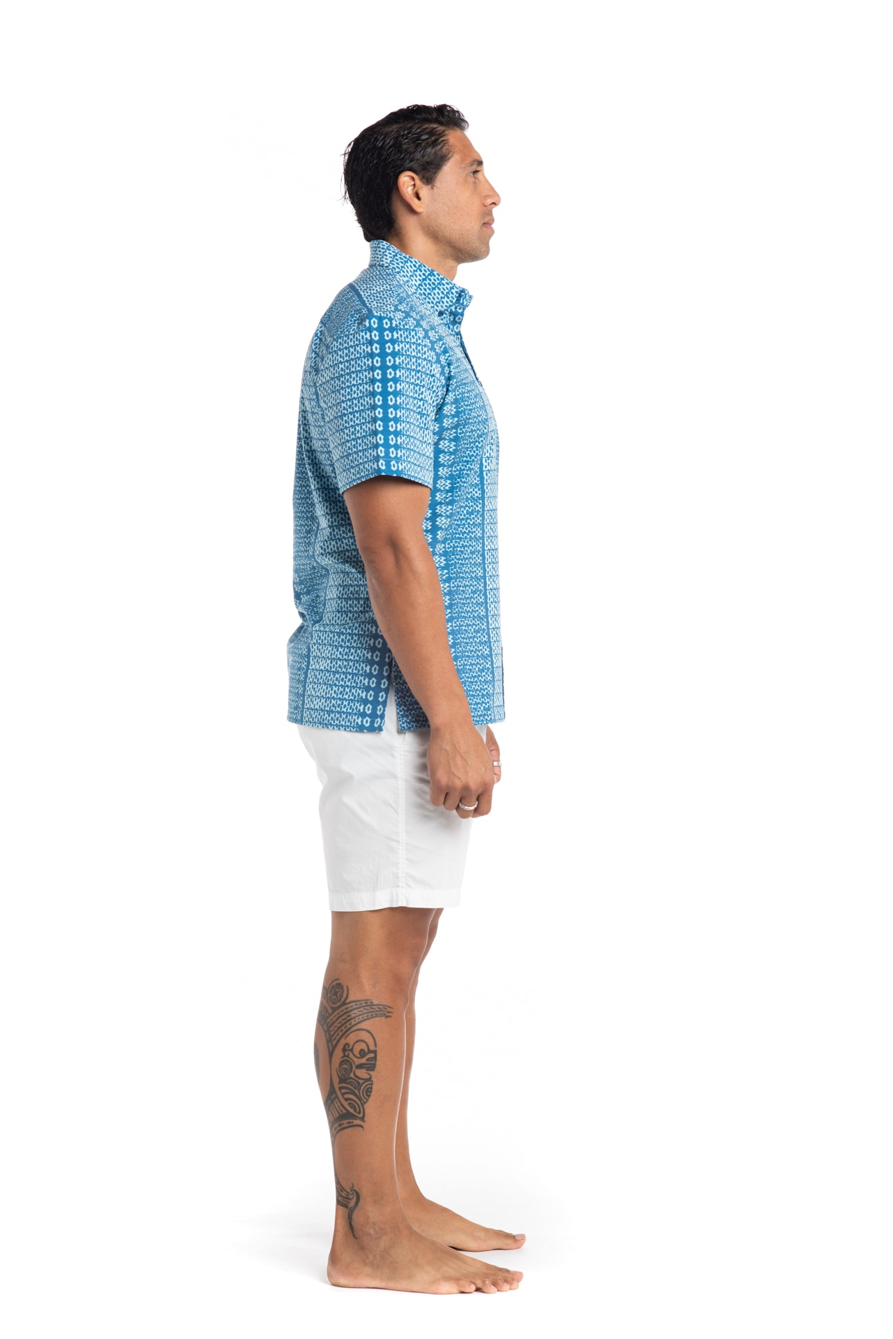 Male model wearing Mahalo Nui Shirt in Light Blue - Side View