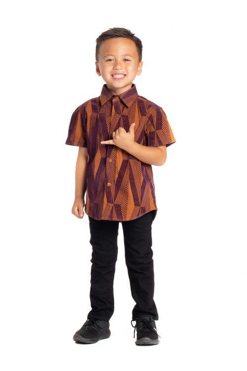 Boy wearing Keiki Aloha Short Sleeve in Red Mahagony Kanaloa - Front View