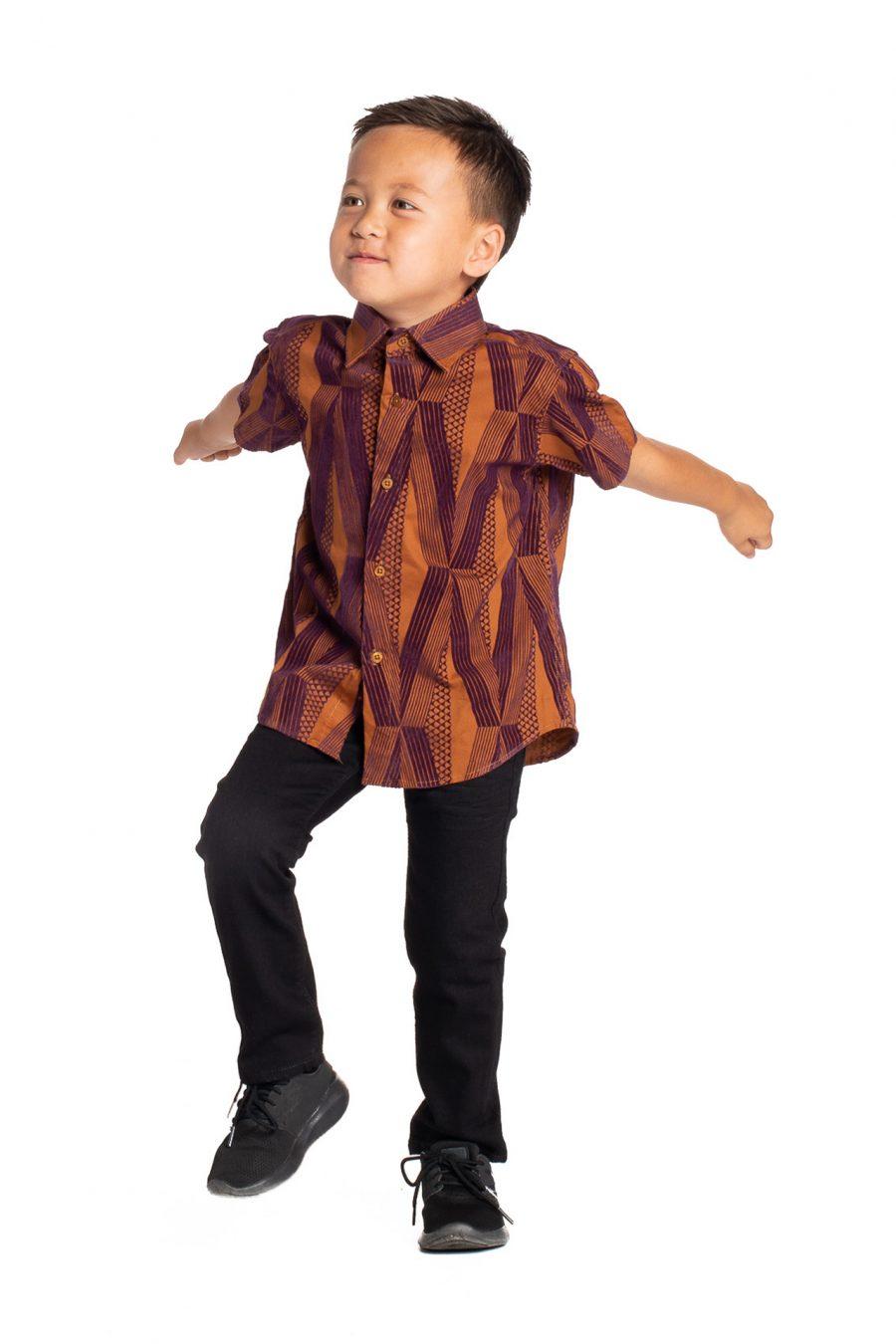 Boy wearing Keiki Aloha Short Sleeve in Red Mahagony Kanaloa - Side View