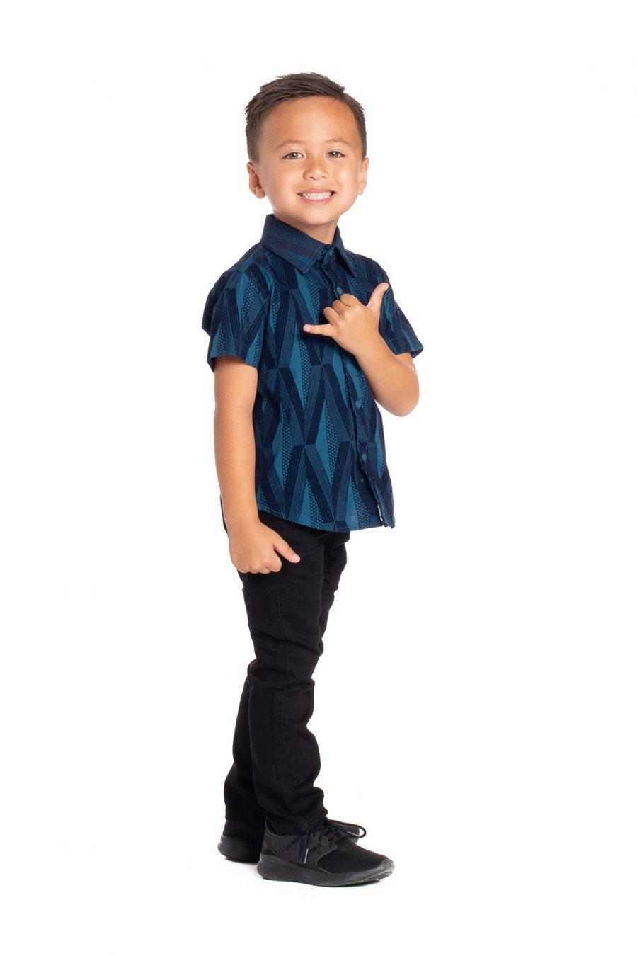 Boy wearing Keiki Aloha Short Sleeve in Teal Kanaloa - Side View
