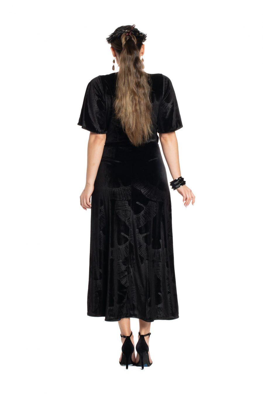 Model wearing Peahi Wrap Dress in Black - Back View