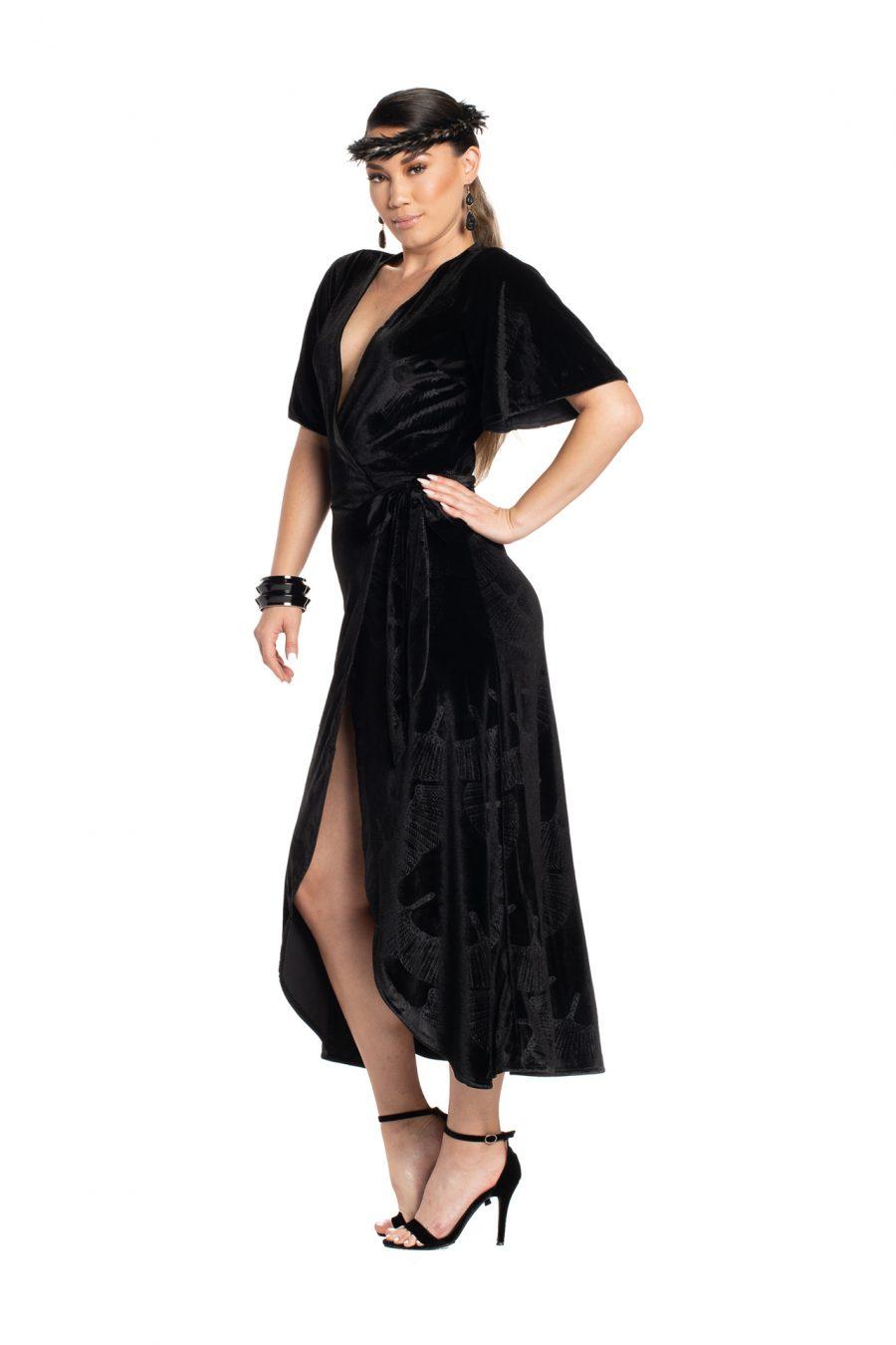 Model wearing Peahi Wrap Dress in Black - Side View