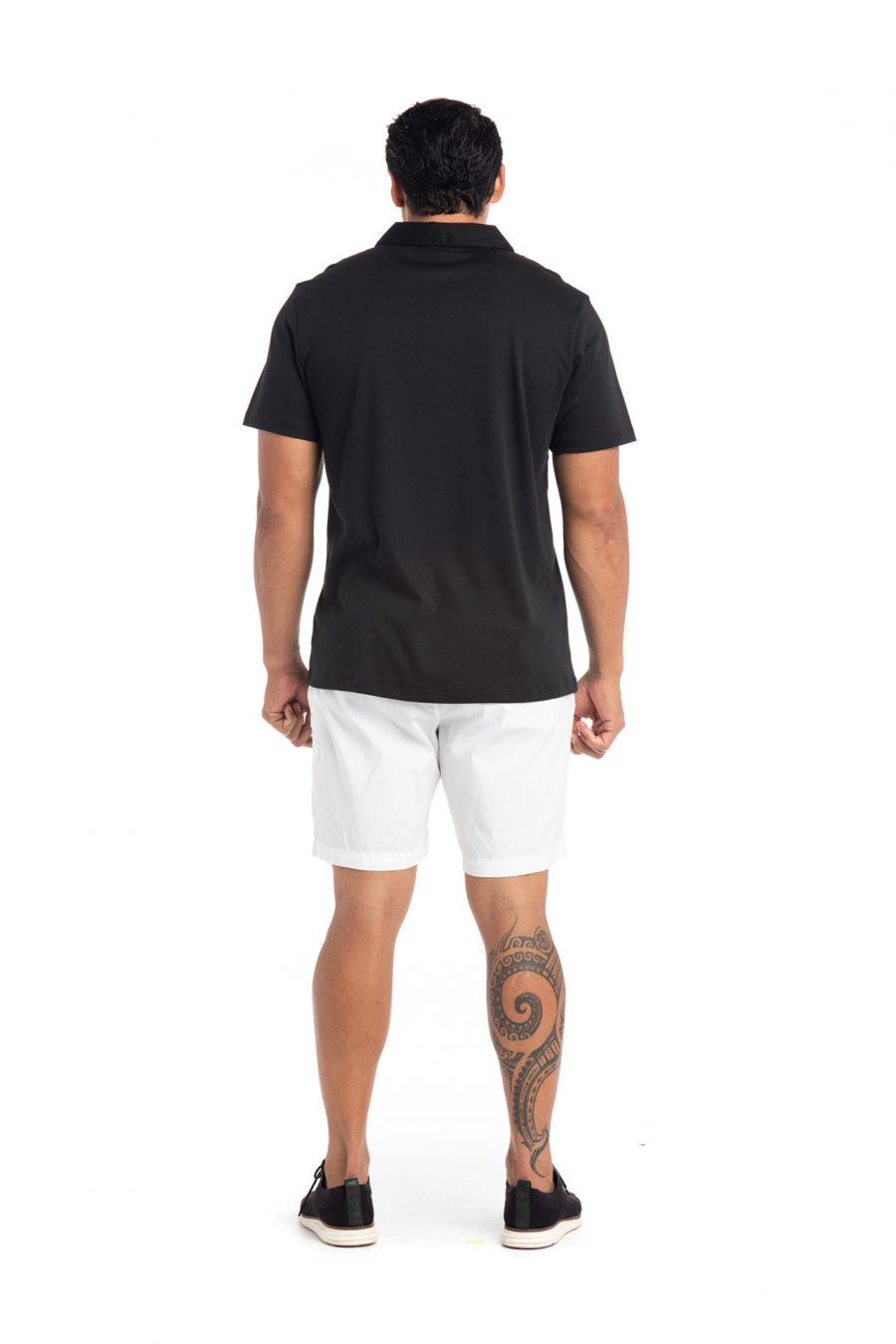 Male model wearing Waikii Polo in Black - Back View